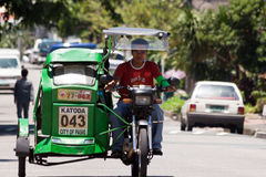 Tricycle cab driver Royalty Free Stock Image