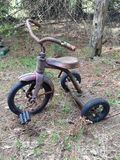 Tricycle. Forgotten about little kids steel Tricycle royalty free stock image