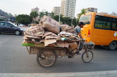 Tricycle full of waste, in Shenzhen, China Stock Photo