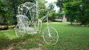 Tricycle in the garden Royalty Free Stock Photography