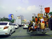 Tricycle loaded with passengers. In a major highway in manila philippines in asia Stock Photography