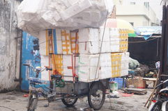 Tricycle loaded with plastic boxes. In Shenzhen Xixiang, China stock image