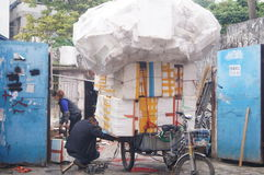 Tricycle loaded with plastic boxes. In Shenzhen Xixiang, China stock photos