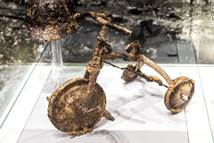 Tricycle and metal helmet of Shinichi Tetsutani exposed in Hiroshima, Japan. Hiroshima, Japan - April 28, 2014: The Shinichi Tetsutani tricycle exposed at the Stock Photography