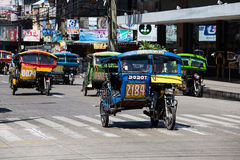 Tricycle motor taxi, Philippines. DUMAGUETE, PHILIPPINES - FEBRUARY 18, 2014 :Tricycle motor taxi, Philippines inexpensive transport service. Tricycle motor taxi Royalty Free Stock Photos