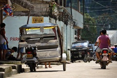Tricycle motor taxi in the streets of Philippines resort town. Stock Photography