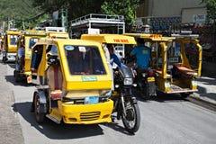 Tricycle motorisé images stock