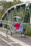 Tricycle on old bridge Royalty Free Stock Image