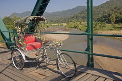 Tricycle on old bridge Stock Images