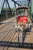 Tricycle on old bridge Royalty Free Stock Images