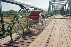 Tricycle on old bridge - memorial bridge in Pai Royalty Free Stock Images