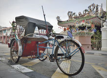 Rickshaw and Temple in old penang street Stock Photo