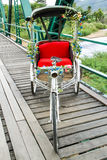 Tricycle on Pai history bridge Royalty Free Stock Image