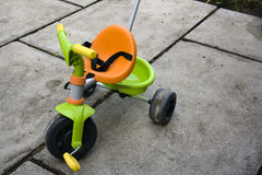 Tricycle. Plastic tricycle for little childdren Stock Photo