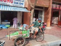 Tricycle Rider. A tricycle rider taking a rest by the roadside in Ho Chi Minh City, Vietnam Royalty Free Stock Images