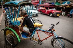 Tricycle (Sam Law) driver having food Royalty Free Stock Photos