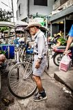 Tricycle (Sam Law) driver stands and waits Royalty Free Stock Images