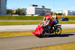 Tricycle sightseeing. Sightseeing Reykjavik coast in trycicle, iceland Royalty Free Stock Images