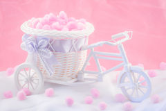 Tricycle souvenir on a pink background with fluffy donuts.  stock images