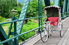 Tricycle thai style on Bridge over Pai River at Pai at Mae Hong Son Thailand. Pai is a small town in Mae Hong Son Province, Northern Thailand, near the Myanmar Royalty Free Stock Image