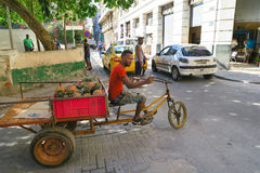 Tricycle transport which delivers fruit and vegetables in Havana. Cuba, Havana - 07 April, 2016: a tricycle transport of Havana, a typical mechanical taxi with a Royalty Free Stock Photo