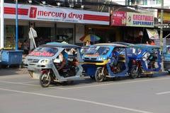 Tricycles motorisés un transport de passagers Philippines photo stock