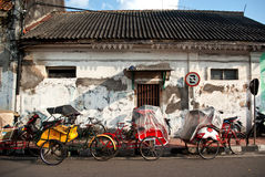 Tricycles on the street side. Bechaks, tricycles on the street side, yogyakarta Stock Images