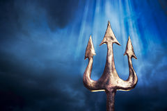 Trident on a dramatic background Stock Images