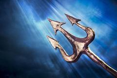 Trident on a dramatic background Royalty Free Stock Images