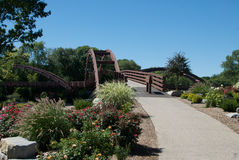 Tridge Three Bridges. The iconic landmark of Midland, Michigan, in the USA; three bridges that meet in the center of a river, surrounded by a park and gardens Stock Photos