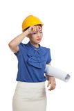 Tried Asian engineer woman with blueprints Stock Photography