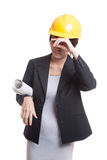 Tried Asian engineer woman with blueprints. Royalty Free Stock Photo