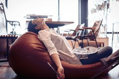 Tried overworked female artist sleeping while working. Tried overworked young female artist sleeping while working Royalty Free Stock Photos