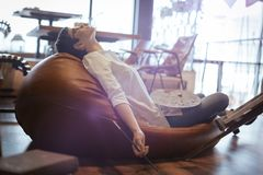 Tried overworked female artist sleeping while working Royalty Free Stock Image