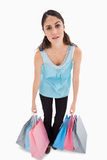 Tried woman posing with shopping bags Stock Image
