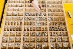 Trier des lettres dans le cadre Photographie stock libre de droits