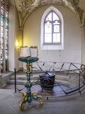 A beautiful lectern and a baptismal font in St. Gangolf Church - the second oldest church building in the oldest town of. TRIER, GERMANY - APRIL 29, 2015 stock photography