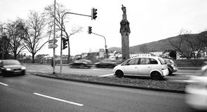 Cars and statue of Emperor Constantine holding a crown. TRIER, GERMANY - FEB 21, 2015: Cars and statue of Emperor Constantine holding a crown with a cross,ratop Stock Photo