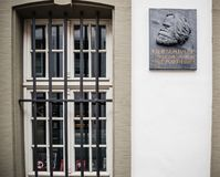 Commemorative plaque on the facade of Karl Marx house. TRIER, GERMANY - FEB 21, 2015: Front view of commemorative plaque on the facade of the house were Karl Stock Photo
