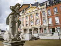The Gardener - a statue by Ferdinand Tietz in front of the Electoral Palace and the Aula Palatina royalty free stock images