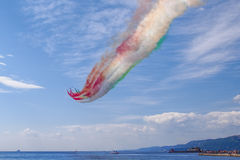 Trieste. Air show of Frecce Tricolori. Air show of Italian Frecce Tricolori team. Colored contrails with the colors of the Italian flag Royalty Free Stock Images