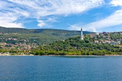 Trieste, the architectures and arts. Italy, Trieste, view of the Faro della Vittoria on the Riviera seafront Stock Image