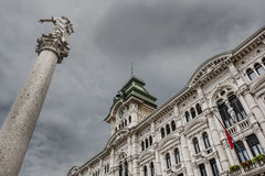Trieste city hall and column of Charles VI of Habsburg. Royalty Free Stock Photos