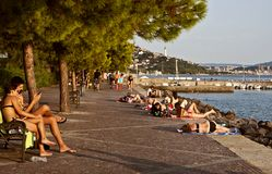 Summer in Trieste, sea promenade. Trieste Italy, Barcola sea promenade at sunset, people enjoy the summer warm weather Royalty Free Stock Photography