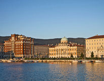Trieste, Italy, Rive at sunset with neo-classical Carciotti pala Royalty Free Stock Photos