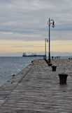 Trieste old harbour pier, Italy. Winter scene. Royalty Free Stock Images