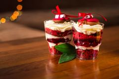Trifle with sponge cake and red cherry, with a bow of red ribbon and a note with a prediction royalty free stock photo