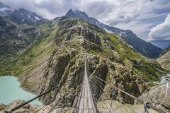 TRIFT HANGING BRIDGE. SWISS ALPS NATURE. MOUNTAIN LANDCSAPE. TRIP IN SWITZERLAND. TOP OF ATTRACTION. HIKER MAP. MOUNTAIN LANDSCAPE. HANGING BRIDGE royalty free stock photography