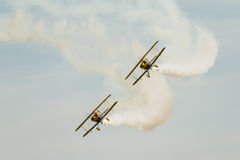 Trig aerobatic team. Duo, displaying their Pitts Specials at Abingdon Air Show, UK, during May 4th 2014 stock photo