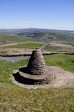 Trig Point Buttertubs Pass. The Buttertubs Pass is a high road in the Yorkshire Dales. The road winds its way from Muker and Thwaite, North Yorkshire near 20 Royalty Free Stock Images